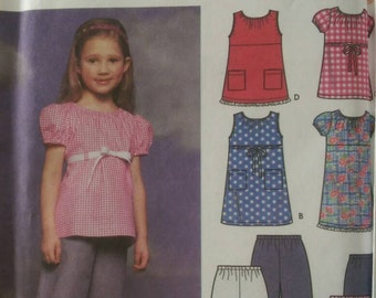 Simplicity 9793. New and factory folded. Child's Dress, Top and Pants or Shorts pattern.