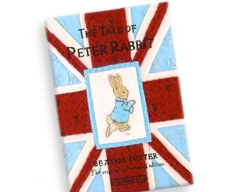 Book clutch with leather frame - The Tale of Peter Rabbit by Beatrix Potter. Hand-embroidered book handbag lined with Liberty print fabric