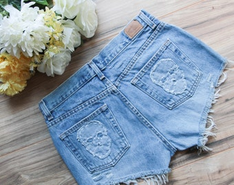 High waist vintage denim shorts Size 8 | Ripped distressed shorts | Skull embroidered patch denim | Hipster festival light wash shorts |