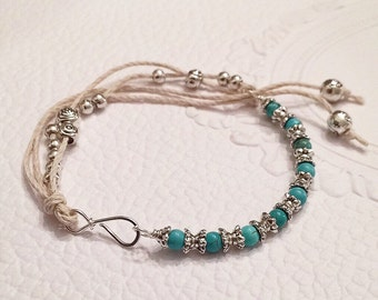 Adjustable Turquoise and Tibetan silver beads bracelet handmade with Sterling silver wire and hemp cord