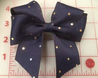 Navy with gold polka dot hair bow