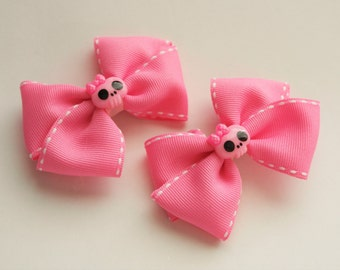 Pair of Pink Skeleton Hair Bow Clips