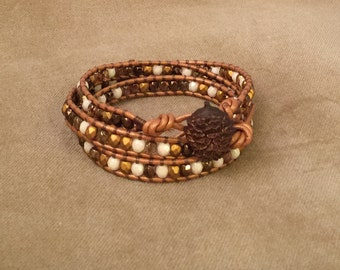 Beaded leather wrap bracelet with pine cone