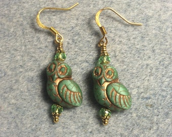 Green with copper wash fancy Czech glass owl bead earrings adorned with green Chinese crystal beads.