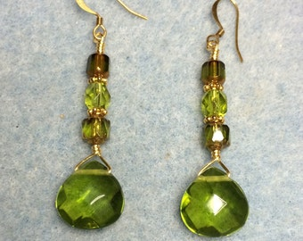 Olive green briolette dangle earrings adorned with olive green Czech glass beads.