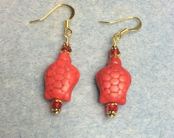 Red howlite turtle bead earrings adorned with red Chinese crystal beads.