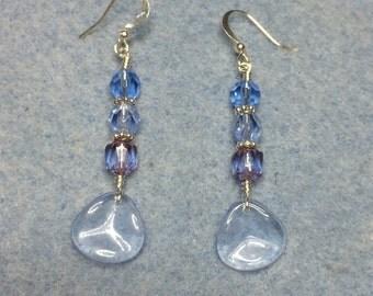 Light blue Czech glass rose petal dangle earrings adorned with light blue Czech glass beads.