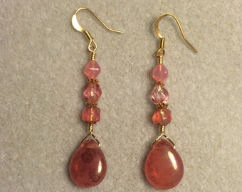 Watermelon pink Czech glass pear drop earrings adorned with pink Czech glass beads.