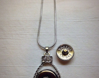 Snappy Chicks teardrop pendent with scroll work around the edge.