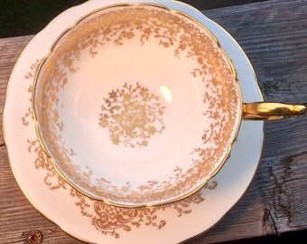 Another Coalport Stunner: Gold on White Footed Teacup and Saucer