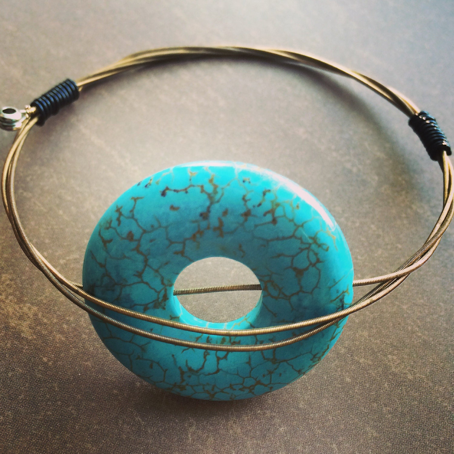 guitar string bangle with large turquoise bead. Black Bedroom Furniture Sets. Home Design Ideas