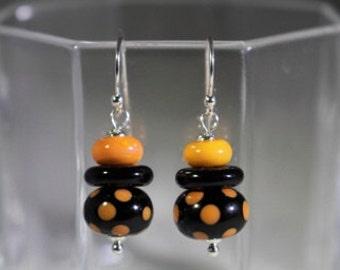 Black and orange polka dot lampwork beads