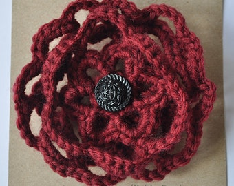 Crocheted red flower corsage