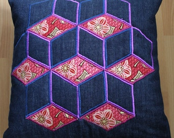 Geometric applique and machine embroidered cushion