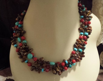 three strand necklace made with natural coral, red jasper and turquoise