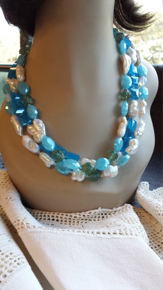 Three strand necklace made with faceted artist glass, freshwater pearls and opulite