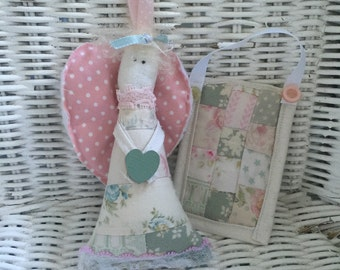 Small angel with her own quilt, she is a decoration and not a toy
