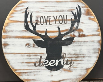 "Heavily distressed ""love you deerly"" circular sign"