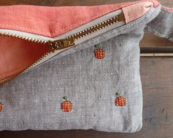 Cute oranges cross stitched on a 100% linen zippered pouch, padded to protect precious little things.