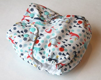 SALE - PUL pocket cloth diaper (penguins skating), microfleece-lined, one-size, snap fasteners