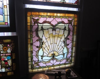 c. 1890 Antique Stained Glass Window, w/ a sunrise, 16 jewels / 52 roundels, original frame