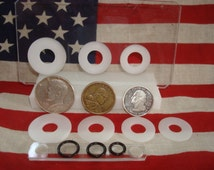 U.S. LARGE COIN center punch card fits the fifty cent piece, small dollar, and quarter.
