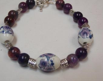 Hand made one of a kind beaded bracelet w/ porcelain flower beads