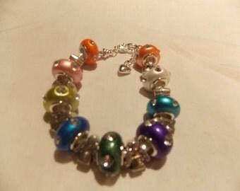 Hand made one of a kind bracelet w/porcelain/rhinestone beads