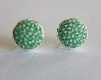 Green and white spotty fabric button stud earrings.