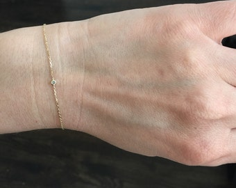 14k solid yellow gold and blue diamond everyday bracelet.