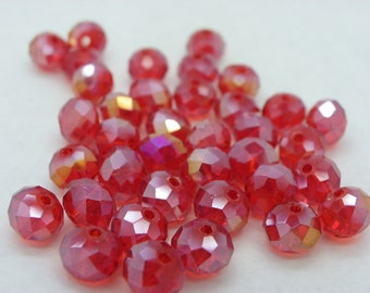 50 style glass beads Crystal has red faces Clearcoats