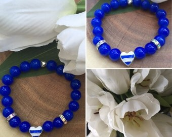 Blue bracelet with white and blue heart charm