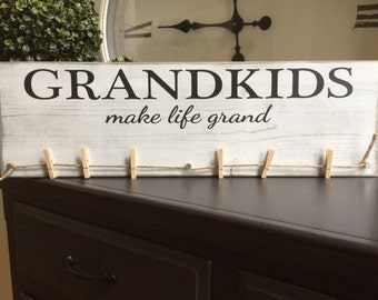 Grandkids Make Life More Grand. Great Christmas Gift!! Hand painted wood sign with six clothespins for picture displaying.