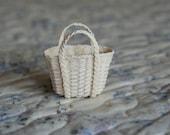 A miniature  ivory wicker basket