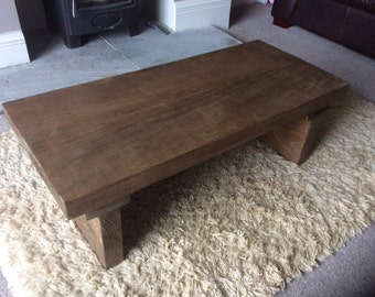 Rustic handcrafted reclaimed chunky wooden coffee table in walnut wax