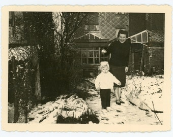 First snow- original 50s vintage photo- mother and cute child checking out the fresh snow- winter decor- family snapshot- paper ephemera