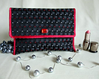 Clutches in multicolor (black, red, white).