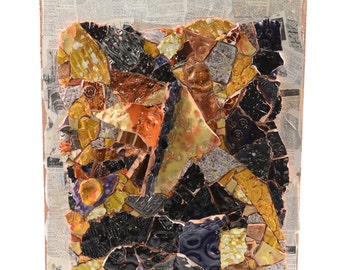 Ceramic mosaic abstract multicolor shades of black orange yellow on coated medium of dictionary with rustic vintage page