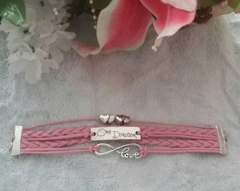 Woven and braided friendship bracelet with charms