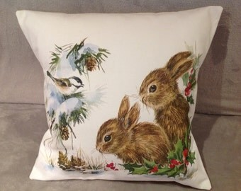 Winter scene cushion/pillow with rabbits