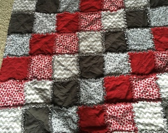 Red, grey, and white rag throw