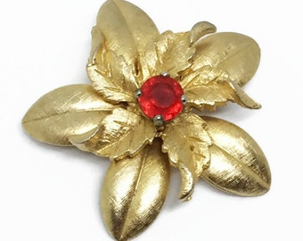 Vintage Gold Tone Flower Brooch with Red Rhinestone