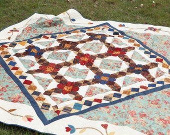 Country style quilt. Red white blue and brown