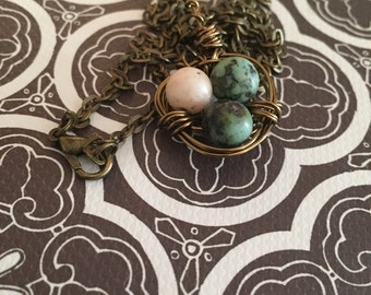 Beautiful, 3 eggs in birds nest pendant with chain