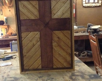 Shadow box cross, made from reclaimed wood. The cross is made from birch plywoodand the frame made from pine.