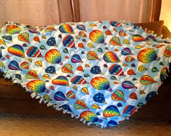 Do you love Hot air balloons? Well cuddle up and stay warm with this fleece blanket