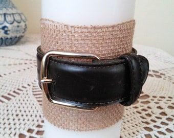 Dark brown belt candle