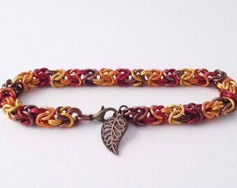 Fall colors byzantine weave chain maille bracelet with a leaf charm