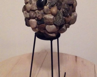 River rock gazing ball on stand
