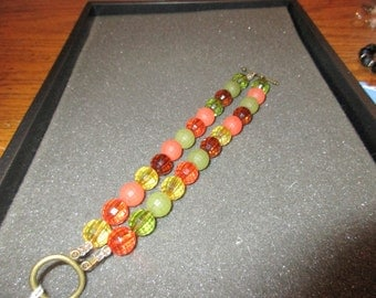 Bright green, orange, yellow and brown double row bracelet.